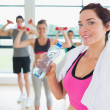 Woman taking break from aerobics class - Stock Photo