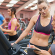 Gym Instructor and woman in the gym — Stock Photo