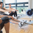 Woman looking up from rowing machine workout — Stock Photo