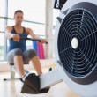 Stock Photo: Rowing machine being used