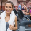 Woman drinking water in the gym — Stock Photo #23052814
