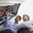 Technicians checking wires of server — Stock Photo #23052966
