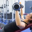 Woman lifitng weights — Stock Photo #23052974