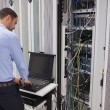 Man repairing servers — Stock Photo #23053074