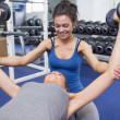 Stock Photo: Trainer teaching womlifting weights