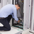 Stock Photo: Mdoing maintenance and fixing wires on server