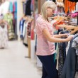 Woman looking at clothes - Stock Photo