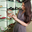 Woman looking at shoes - Stock Photo