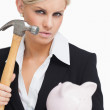 Beautiful businesswoman holding a hammer and a piggy-bank — Stock Photo