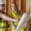 Two architects checking blueprints — Stock Photo #23053522