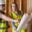 Stock Photo: Two architects checking blueprints