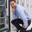 Smiling man checking the servers - Stock Photo