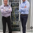 Two technicians standing in front of servers - 