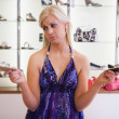 Woman is choosing shoes — Stock Photo