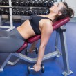 Stock Photo: Exhausted womtraining with weights