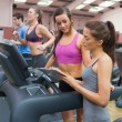 Female Gym Instructor and woman in the gym — Stock Photo