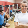 Stock Photo: Female trainer smiling in front of class