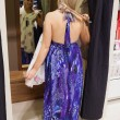 Woman standing in the changing room trying clothes — ストック写真