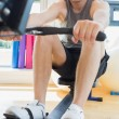 Stock Photo: Mrowing at row machine