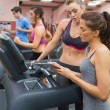 Female Instructor and woman in the gym — Stock Photo