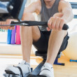 Man working out on row machine — Stock Photo #23054386