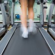 Stock Photo: Feet running on treadmill