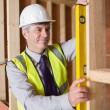 Architect measuring wood frame — Stock Photo