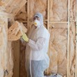 Worker filling walls with insulation — Lizenzfreies Foto
