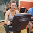 Stock Photo: Smiling womin spin class