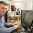 Smiling man in computer class — Stock Photo