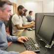 Man in computer class - Stock Photo