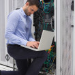 Concentrated technician doing data storage — Stock Photo