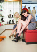 Women searching for shoes — Stock Photo