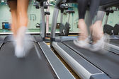 Two running on treadmills — Stock Photo