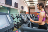 Woman running on a treadmill in a gym — Stock Photo