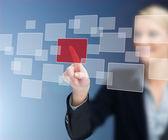 选择红色正方形的女商人 — 图库照片