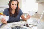 Young woman getting stressed over finances — Stok fotoğraf