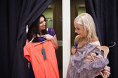 Women standing in a changing room talking — Стоковое фото