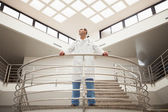 Doctor standing in stairwell looking around — Stock Photo