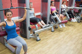 Four women training on weight machines — Stock Photo