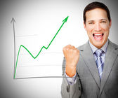 Businessman celebrating behind increasing graph — Stock Photo