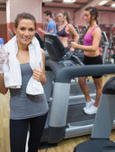 Woman holding towel in gym — Stock Photo