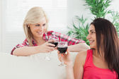 Women drinking wine at home — Stock Photo