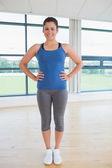 Happy woman in fitness studio — Stock Photo
