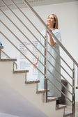 Female patient walking up stairs — Stock Photo