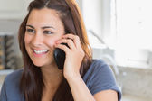 Smiling woman calling — Stock Photo