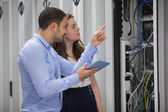Technicians looking at servers — Stockfoto