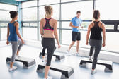 Trainer teaching his aerobic class — Stock Photo