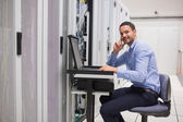 Man looking up from working with servers — Stock Photo