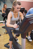 Woman training in a spinning class — Stock Photo